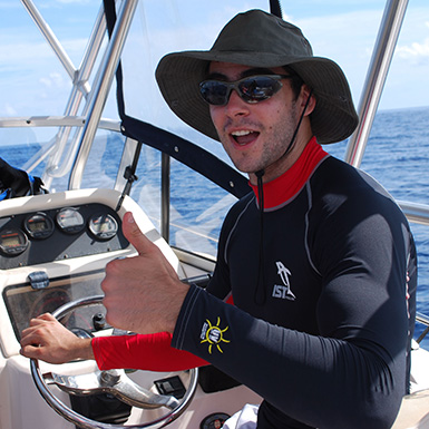 kevin driving the boat while trolling