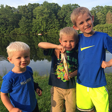 kids fishing catch a bass