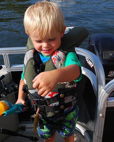 toddler catch fish with push botton pole and a worm