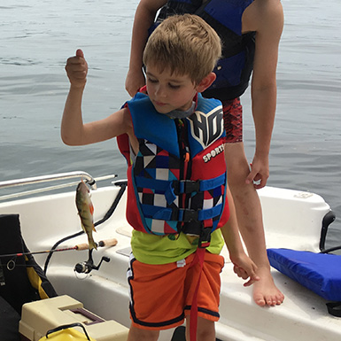 young kid catches a perch