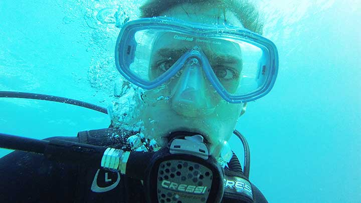 captain cody with a cressi scuba diving regulator