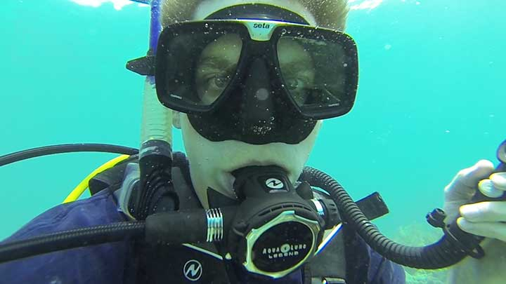 scuba diving with aqua lung regulator