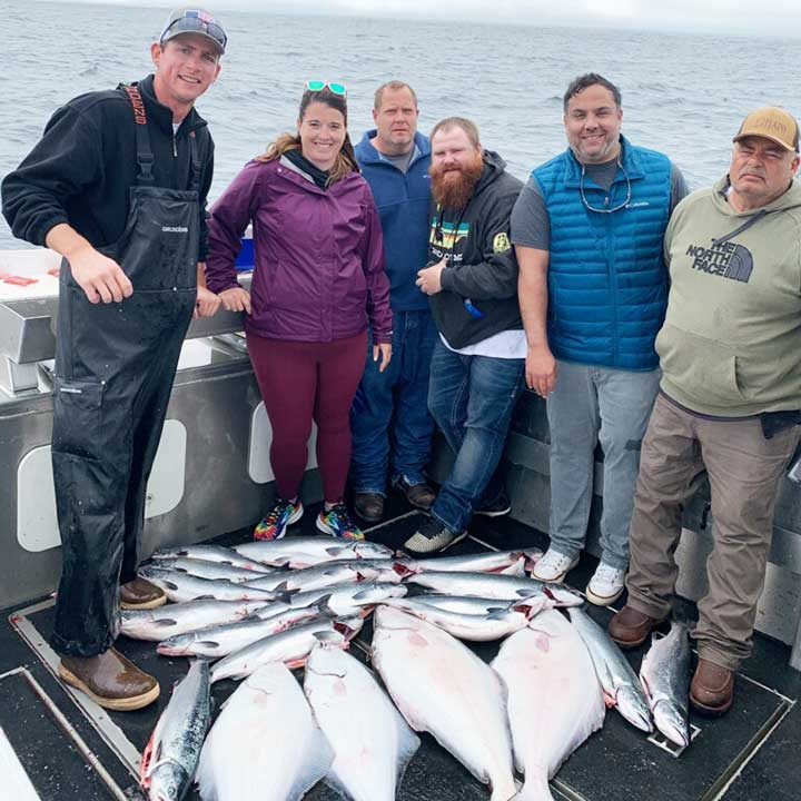catching salmon and halibut on salmon fishing trip in alaska