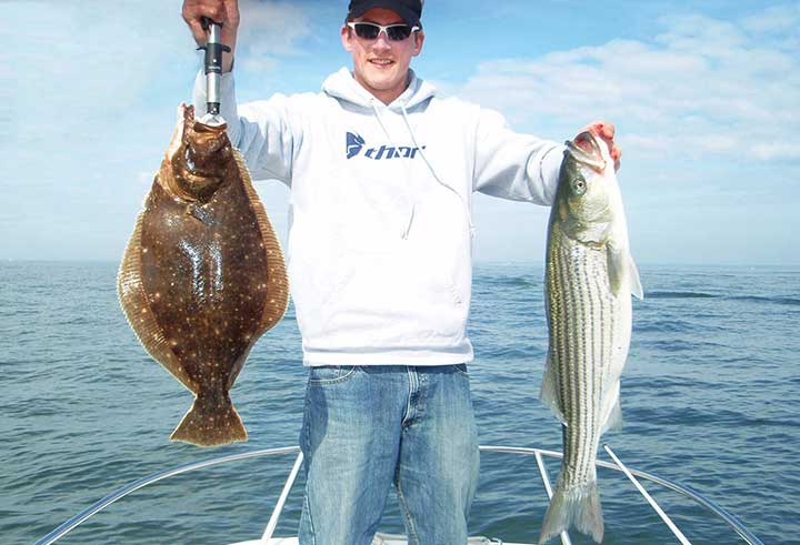 captain cody catches a huge fluke and striped bass in new jersey