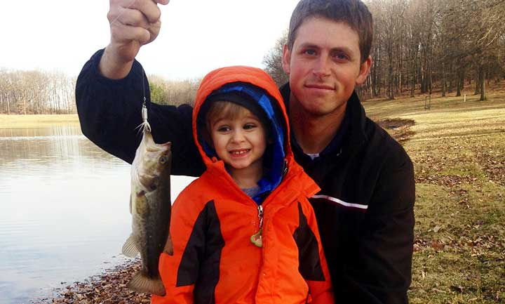 kid catches bass on a roster tail spinner bass lure