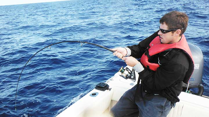 mark jigging for tuna offshore