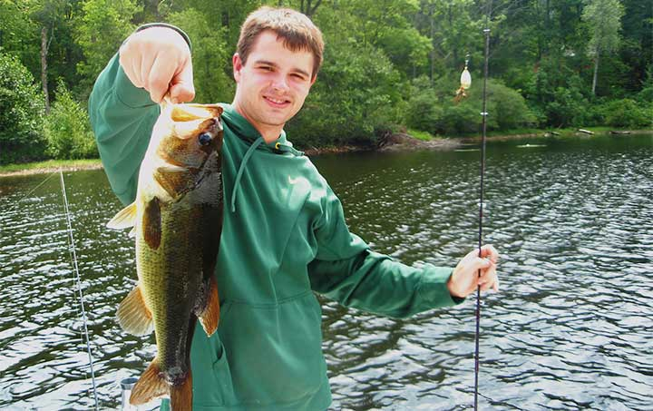 mike with a bass caught on a mepps spinner bass lure