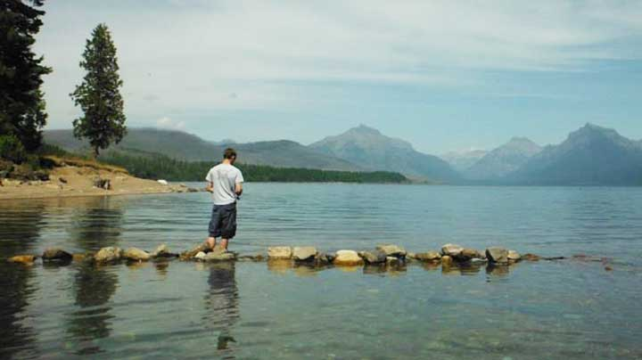 trout fishing for trout in a lake at glacier national park