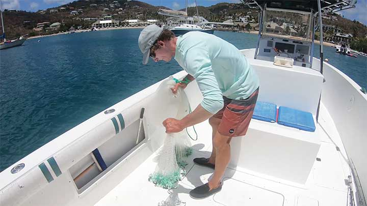 collect about half the cast net by pulling from the front of the net